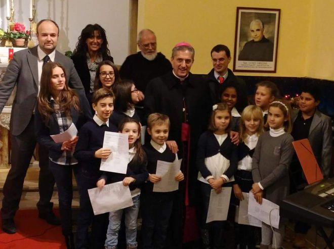 Il vescovo Viola ha celebrato la messa dei malati in ospedale con le voci bianche dell'Accademia Perosi